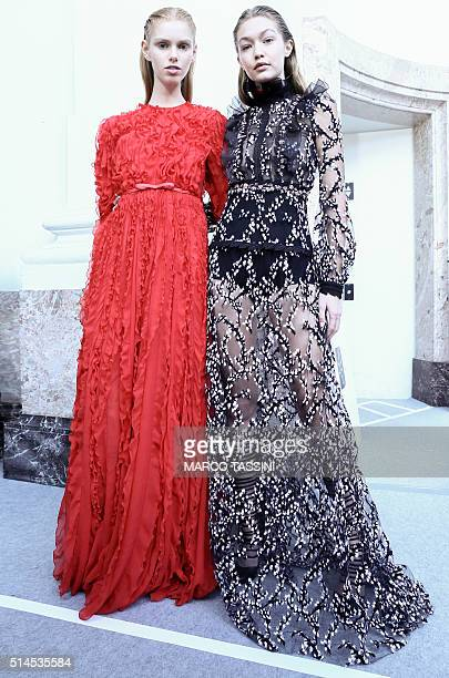 Gigi Hadid poses with another model backstage before the Giambattista Valli show as part of the Paris Fashion Week Womenswear Fall/Winter 2016/2017...