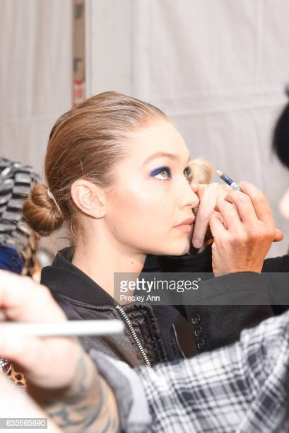 Gigi Hadid prepares backstage at the Anna Sui Fall/Winter 2017 Show at Skylight Clarkson Sq on February 15 2017 in New York City