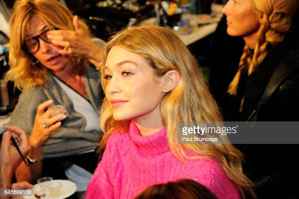 Gigi Hadid prepares backstage at the Anna Sui show during New York Fashion Week The Shows attends Daily Front Row's Fashion Media Awards at Skylight...