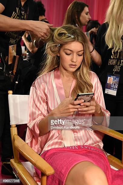 Gigi Hadid prepares backstage before the 2015 Victoria's Secret Fashion Show at Lexington Avenue Armory on November 10 2015 in New York City