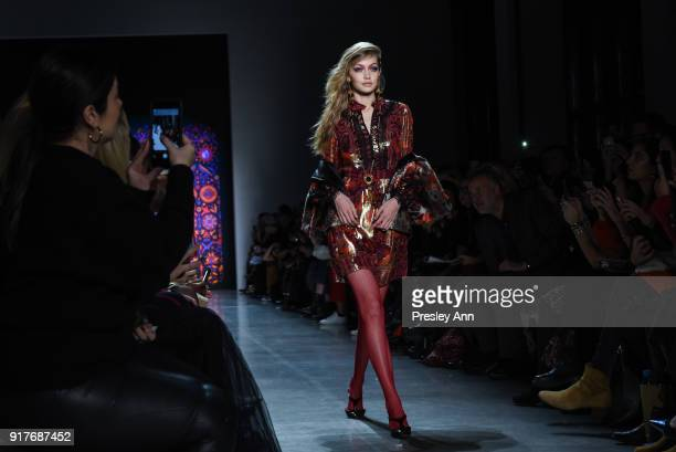 Gigi Hadid walks the runway at Anna Sui Runway February 2018 New York Fashion Week at Spring Studios on February 12 2018 in New York City