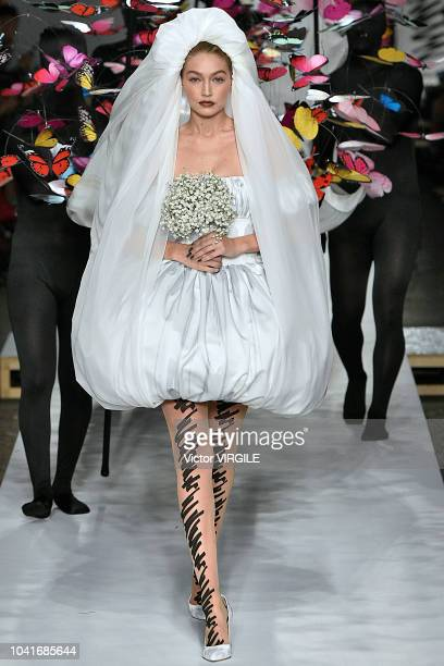 Gigi Hadid walks the runway at the Moschino Ready to Wear fashion show during Milan Fashion Week Spring/Summer 2019 on September 20 2018 in Milan...