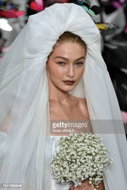Gigi Hadid walks the runway at the Moschino Ready to Wear fashion show during Milan Fashion Week Spring/Summer 2019 on September 20, 2018 in Milan,...