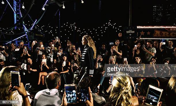 Gigi Hadid walks the runway at the #TOMMYNOW Women's Fashion Show during New York Fashion Week at Pier 16 on September 9 2016 in New York City