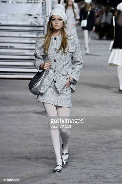 Gigi Hadid walks the runway during Chanel Cruise 2018/2019 Collection fashion show at Le Grand Palais on May 3 2018 in Paris France