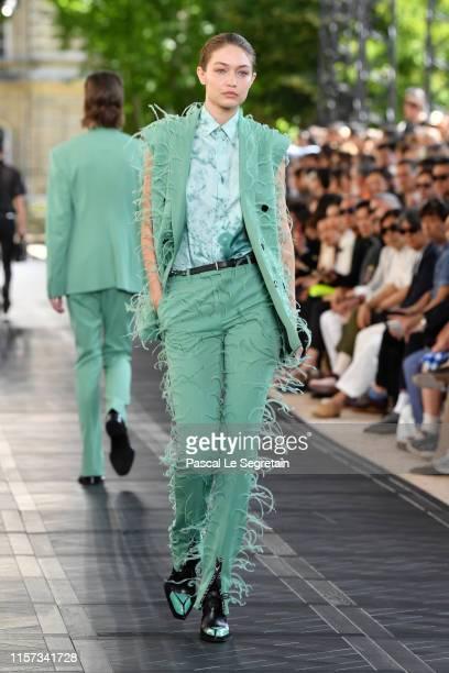 Gigi Hadid walks the runway during the Berluti Menswear Spring Summer 2020 show as part of Paris Fashion Week on June 21 2019 in Paris France