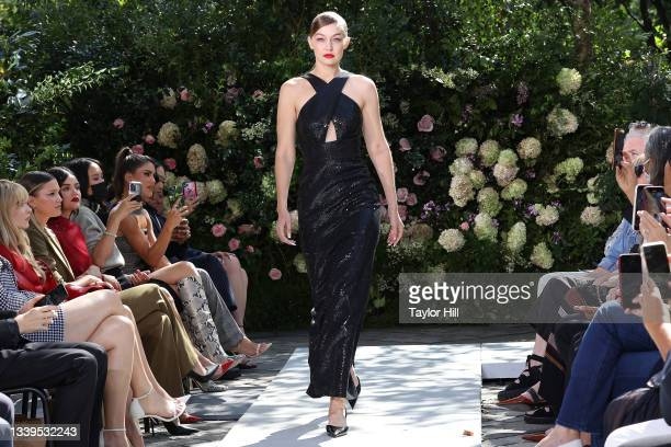 Gigi Hadid walks the runway during the Michael Kors S/S 2022 fashion show during New York Fashion Week at Tavern on the Green on September 10, 2021...