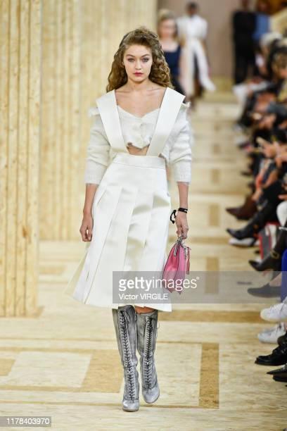 Gigi Hadid walks the runway during the Miu Miu Ready to Wear Spring/Summer 2020 fashion show as part of Paris Fashion Week on October 01, 2019 in...
