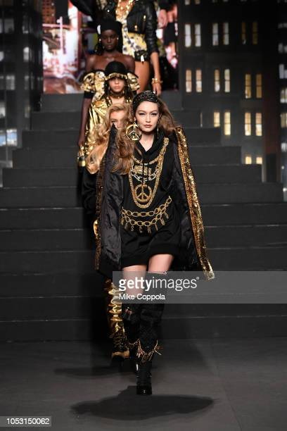 Gigi Hadid walks the runway during the Moschino x HM Runway at Pier 36 on October 24 2018 in New York City