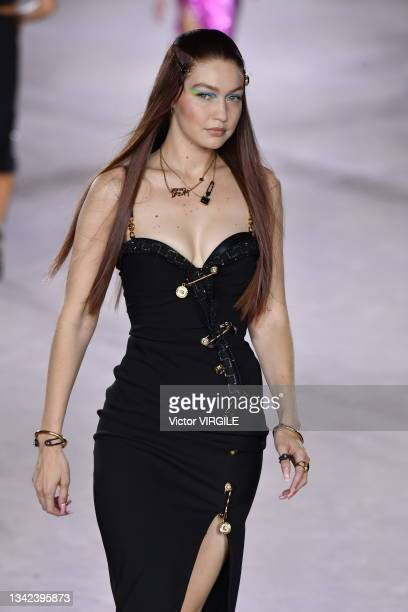 Gigi Hadid walks the runway during the Versace Ready to Wear Spring/Summer 2022 fashion show as part of the Milan Fashion Week on September 24, 2021...