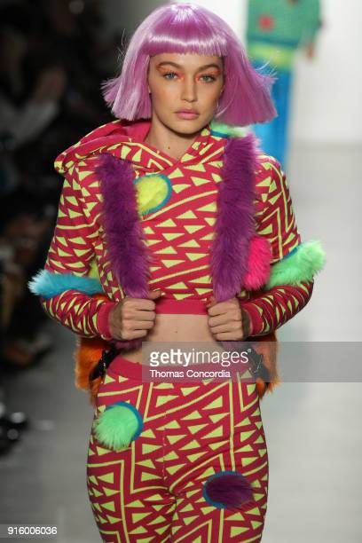 Gigi Hadid walks the runway wearing Jeremy Scott Fall 2018 with make up by Kabuki for MAC and hair by Eugene Souleiman for Wella at Spring Studios on...