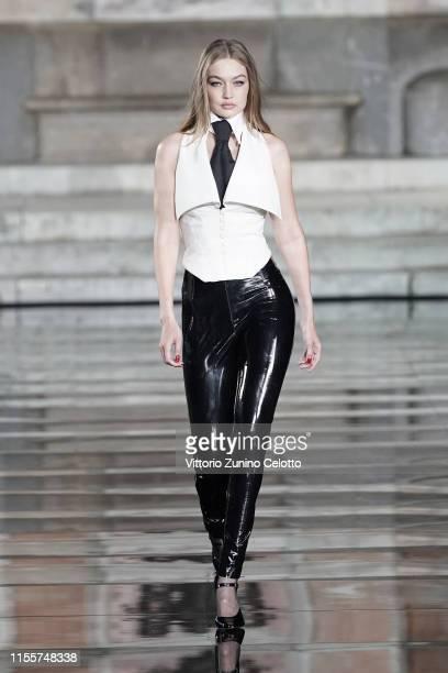 Gigi Hadid walks the runway wearing Karl Lagerfeld at the CR runway x LUISAVIAROMA 90th Anniversary Show during Pitti Immagine Uomo 96 on June 13...