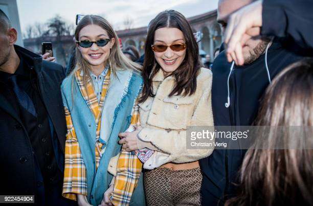 Gigi Hadid wearing denim vest tartan jacket denim button shirt and Bella Hadid wearing cropped top and jacket silk pants seen outside Alberta...