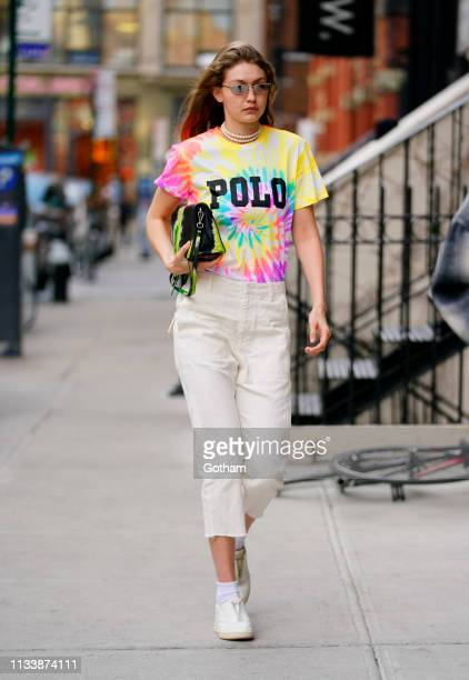 Gigi Hadid wears a tiedyed shirt on March 30 2019 in New York City