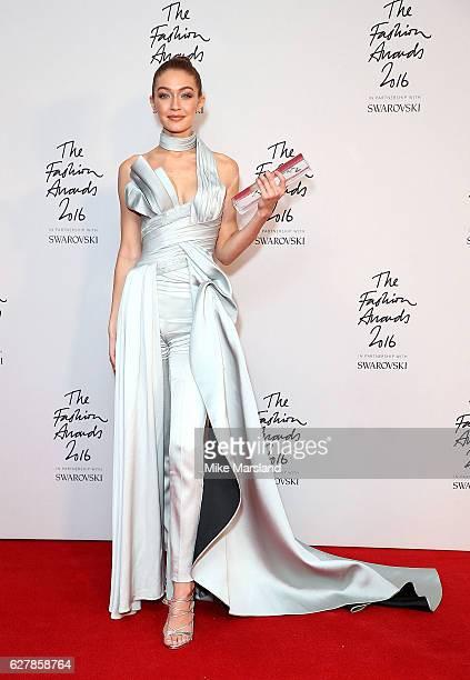 Gigi Hadid winner of the International Model award poses backstage at The Fashion Awards 2016 at Royal Albert Hall on December 5 2016 in London...