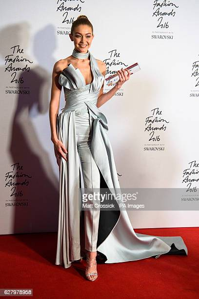 Gigi Hadid with her award for International Model of the Year in the press room during The Fashion Awards 2016 at the Royal Albert Hall London PRESS...