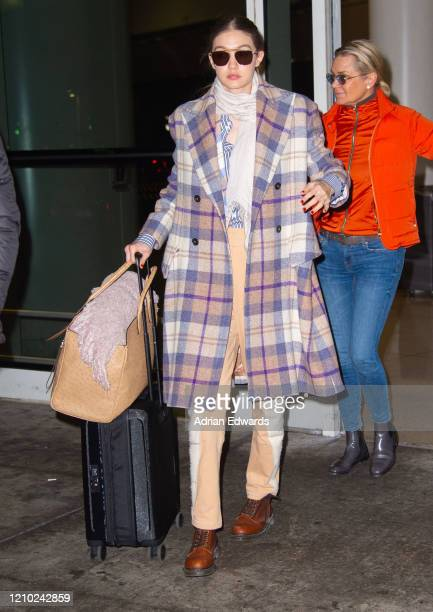 Gigi Hadid with her mother Yolanda Hadid arrive at JFK Airport on March 3 2020 in New York City