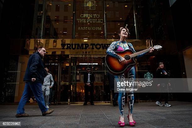 Gigi Love sings a song as she protests in front of Trump Tower November 14 2016 in New York City Trump is in the process of choosing his presidential...