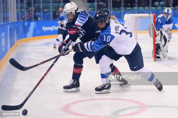 Gigi Marvin of the United States and Linda Valimaki of Finland battle for the puck during the Ice Hockey Women Play-offs Semifinals on day 10 of the...