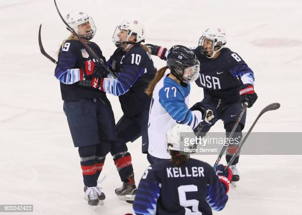 Gigi Marvin of the United States celebrates her first-period goal with Meghan Duggan and Emily Pfalzer against Canada during the Ice Hockey Women...