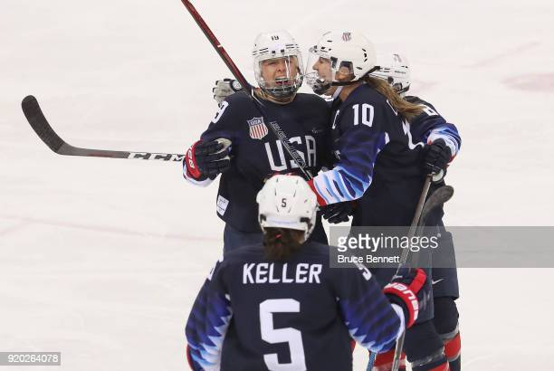 Gigi Marvin of the United States celebrates her first-period goal with Meghan Duggan and Emily Pfalzer against Finland during the Ice Hockey Women...