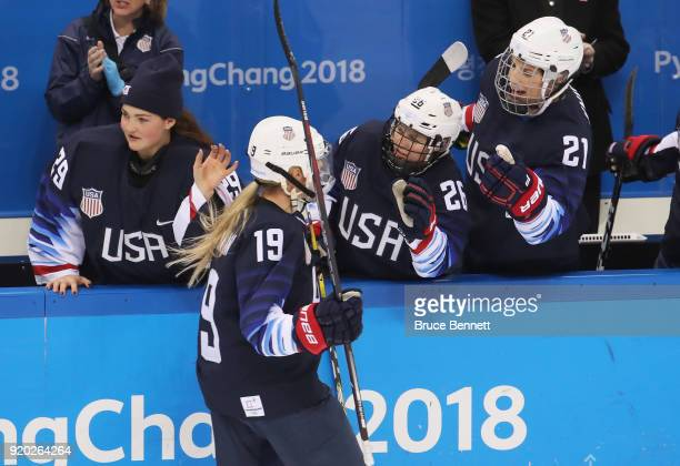 Gigi Marvin of the United States celebrates her first-period goal with the bench against Finland during the Ice Hockey Women Play-offs Semifinals on...