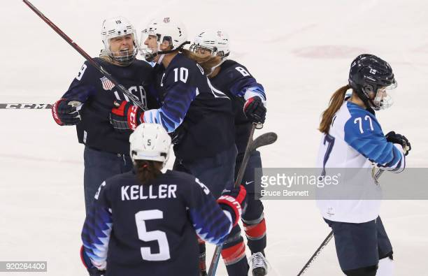 Gigi Marvin of the United States celebrates her first-period goal with Meghan Duggan and Emily Pfalzer as Susanna Tapani of Finland skates away...