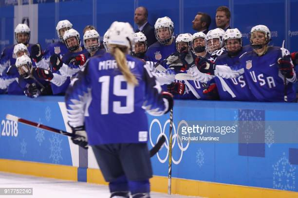 Gigi Marvin of the United States celebrates her second period goal with teammates against Olympic Athletes from Russia during the Women's Ice Hockey...