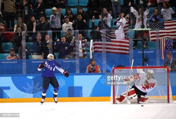 Gigi Marvin of the United States celebrates scoring a goal against Shannon Szabados of Canada in the overtime penalty-shot shootout during the...