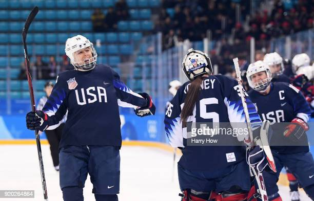 Gigi Marvin of the United States celebrates with teammates after scoring in the first period against Finland during the Ice Hockey Women Play-offs...