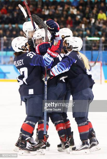 Gigi Marvin of the United States is mobbed by her teamates after scoring a first period goal against Finland during the Ice Hockey Women Play-offs...