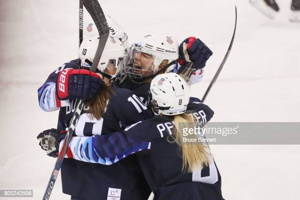 Gigi Marvin of the United States is mobbed by her teammates after scoring a first-period goal against Canada during the Ice Hockey Women Play-offs...