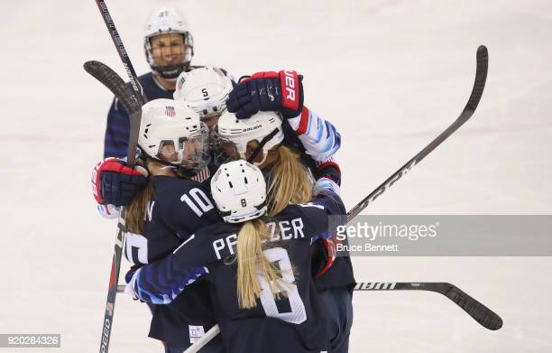Gigi Marvin of the United States is mobbed by her teammates after scoring a first-period goal against Finland during the Ice Hockey Women Play-offs...
