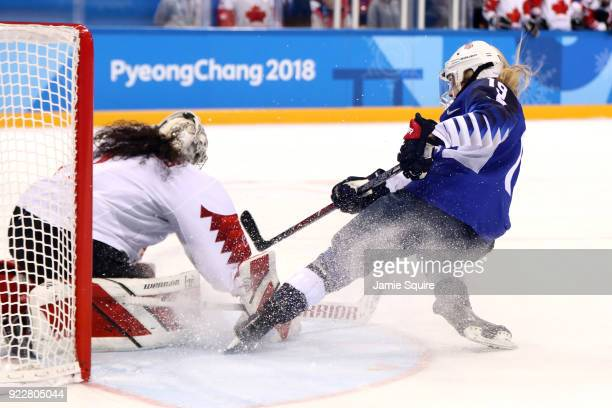 Gigi Marvin of the United States scores a goal against Shannon Szabados of Canada in the overtime penalty-shot shootout during the Women's Gold Medal...