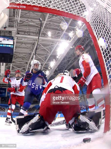 Gigi Marvin of the United States scores a second period goal against Valeria Tarakanova of Olympic Athlete from Russia during the Women's Ice Hockey...