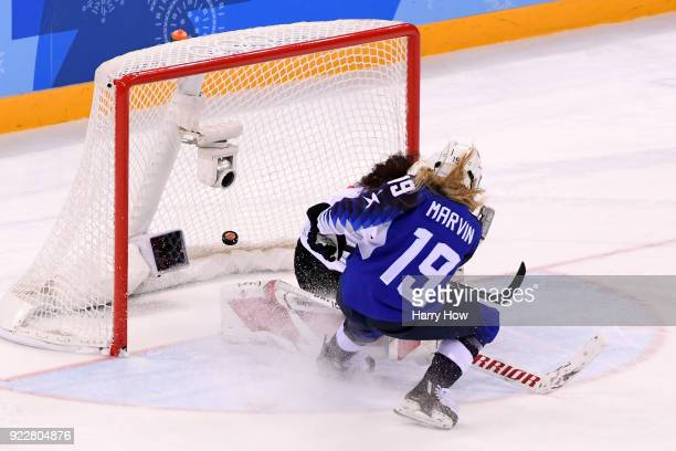 Gigi Marvin of the United States scores during a shootout against Shannon Szabados of Canada during the Women's Gold Medal Game on day thirteen of...