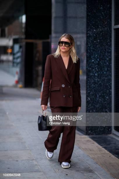 Gigi Vives wearing suit is seen outside Temperley London during London Fashion Week September 2018 on September 15 2018 in London England