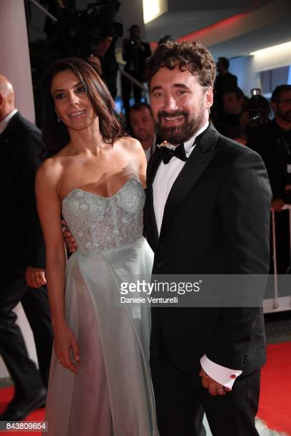 Giglia Marra and Federico Zampaglione walk the red carpet ahead of the 'Mektoub My Love Canto Uno' screening during the 74th Venice Film Festival at...