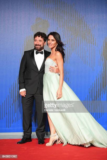 Giglia Marra and Federico Zampaglione walk the red carpet ahead of the 'Manuel' screening during the 74th Venice Film Festival at Sala Giardino on...