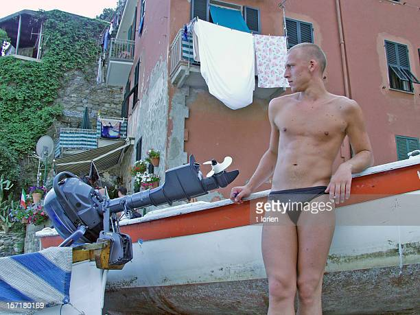 gigolo in italy (or checking out girls) - man wearing speedo stock photos and pictures