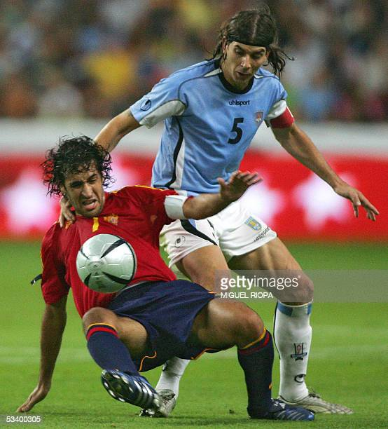 Spain's player Raul Gonzalez vies with Uruguay's Pablo Garcia during their friendly football match, at the Molinon stadium in Gijon, northern Spain,...