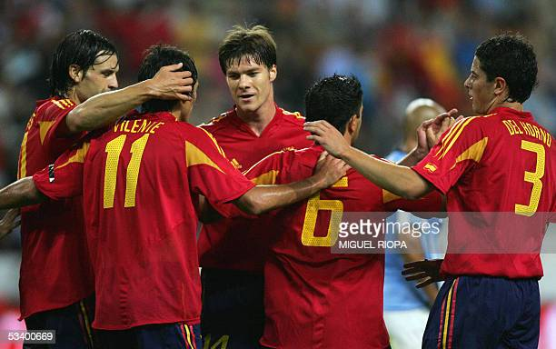 Spain's Vicente Rodrigue celebrates his 1st goal with teammates Fernando Morientes, Xavi Alonso, Xavi Hernandez and Asier Del Horno after scoring...