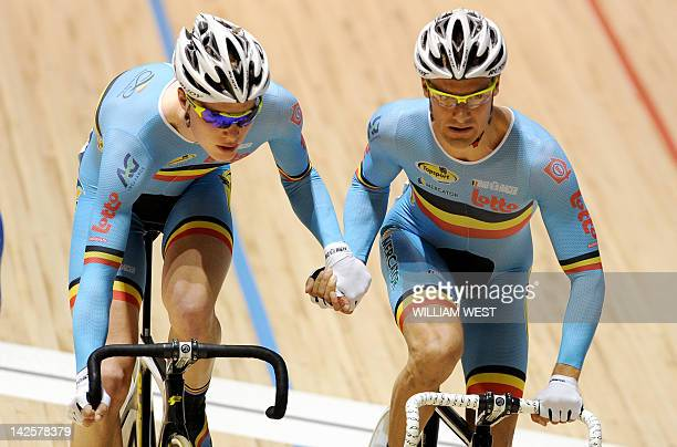 Gijs Van Hoecke and teammate Kenny De Ketele of Belgium speed towards winning the gold medal in the men's madison event at the 2012 Track Cycling...