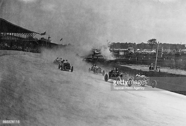 Gil Andersen aboard the Stutz Motor Company Stutz Bearcat racer holding the inside line alongside Teddy Tetzlaff driving the FIAT followed by Len...