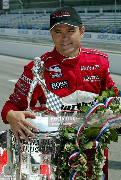 Gil de Ferran driver of the Marlboro Team Penske Toyota Panoz G Force poses with the BorgWarner Trophy on the day after winning the IRL IndyCar...