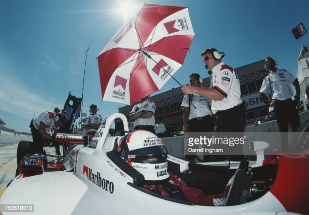 Gil de Ferran of Brazil sits aboard the MarlboroTeam Penske Reynard 01i Honda in the pit lane during practice for the Championship Auto Racing Teams...