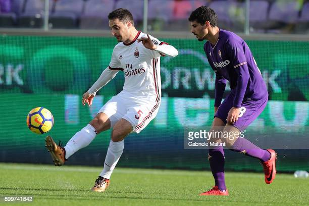 Gil Dias of ACF Fiorentina fights for the ball with Giacomo Bonaventura of AC Milan during the serie A match between ACF Fiorentina and AC Milan at...