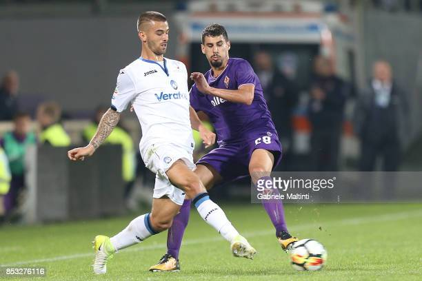 Gil Dias of ACF Fiorentina in action agaist Leonadro Spinazzola of Atalanta BC during the Serie A match between FC Crotone and Benevento Calcio at...