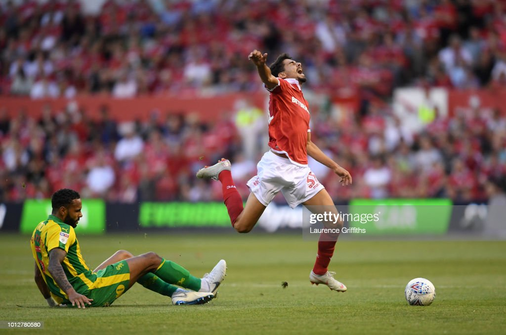 Gil Dias of Nottingham Forest is fouled by Kyle Bartley of West Bromwich Albion during the Sky Bet Championship match between Nottingham Forest and West Bromwich Albion at City Ground on August 7, 2018 in Nottingham, England.