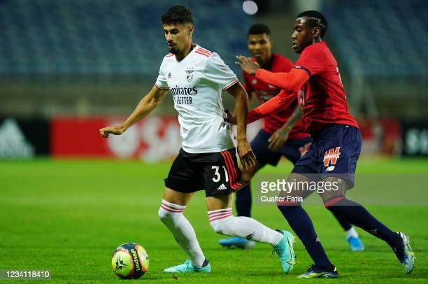 Gil Dias of SL Benfica with Isaac Lihadji of LOSC Lille in action during the Pre-Season Friendly match between SL Benfica and Lille at Estadio...
